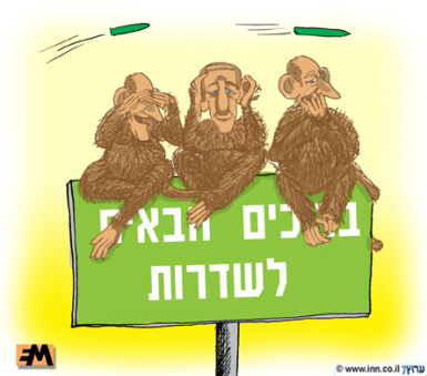 Olmert sobre un cartel que dice Bienvenidos a Sderot