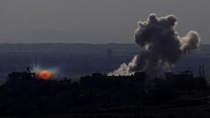 Una imagen tomada el 11 de mayo 2014, desde los Altos del Golán por Israel anexa muestra humo que salía de una explosión durante los enfrentamientos entre los rebeldes y las fuerzas pro-gubernamentales sirias en la ciudad siria de al-Kahtaniyya. (Foto: AFP / Jalaa Marey) Read more: Syrian rebel officer: We could work with Israel to oust Assad, quietly | The Times of Israel http://www.timesofisrael.com/syrian-rebel-officer-we-could-work-with-israel-but-quietly/#ixzz31jYTZrbu  Follow us: @timesofisrael on Twitter | timesofisrael on Facebook