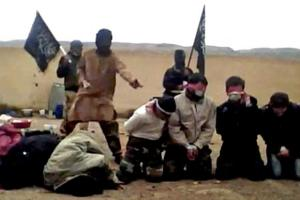 A-still-from-a-video-said-to-show-Jabhat-al-Nusra-killing-Assad-supporters-AFP-ImageForum