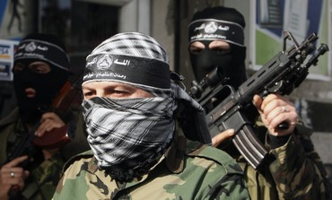 Palestinian gunmen from the Al-Aqsa brigades of Fatah movement attend a news conference in Gaza City