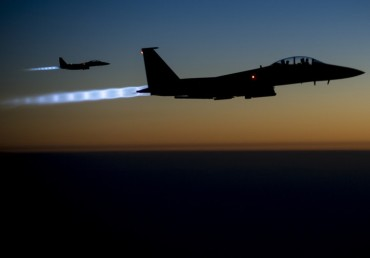 A pair of U.S. Air Force F-15E Strike Eagles fly over northern Iraq
