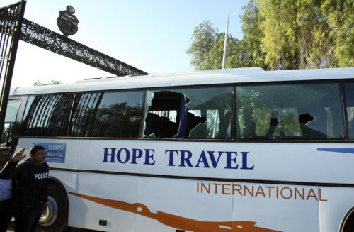 A damaged bus is seen after an attack by gunmen on Tunisia's national museum in Tunis
