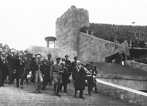 1 Aug 1936:  Adolf HItler (centre front) arrives with officials including Count Henri de Baillet-Latour (front left) President of the International Olympic Committee during the Opening Ceremony of the 1936 Olympic Games in Berlin.  Mandatory Credit: IOCOlympic Museum  /Allsport