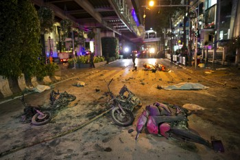 Wreckage of motorcycles are seen as security forces and emergency workers gather at the scene of a blast in central Bangkok August 17, 2015. A bomb on a motorcycle exploded on Monday just outside a Hindu shrine in the centre of the Thai capital, killing at least 12 people, police and a rescue worker said. REUTERS/Athit Perawongmetha