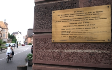 A plaque in memory of 86 Jews killed for Nazi medical experiments at the university of Strasbourg during World War II is pictured at the entrance of the anatomy school in Strasbourg, eastern France, Monday, July 20, 2015. The remains of Jewish gas chamber victims subjected to Nazi anatomy experiments have been traced to a medical research facility in the eastern French city of Strasbourg. A researcher discovered a post-World War II-era letter from the then-director of the Strasbourg Medical Institute about the experiments directed by Nazi anatomist August Hirt. The letter detailed the storage of tissue samples taken from Jews killed in gas chambers built specifically for Hirt's experiments. (AP Photo/Christian Lutz)