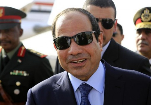 Egypt's President Abdel Fattah al-Sisi smiles upon arrival at Khartoum International Airport in Khartoum June 27, 2014. REUTERS/Mohamed Nureldin Abdallah (SUDAN - Tags: POLITICS) - RTR3W4IZ