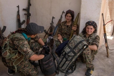 armed-kurdish-female-fighters-from-people-s-protection-units-ypg-talk-to-each-other-in-the-assyrian-village-of-tel-nasri