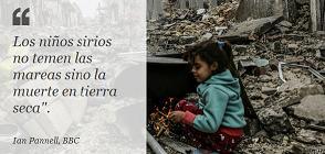 Niña Siria entre escombros