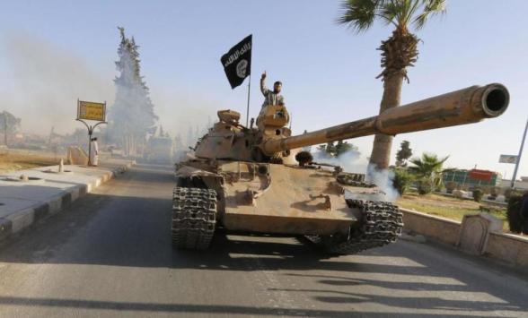 Milicianos del ISIS durante un desfile militar celebrado en su 'capital' siria, Raqqa.