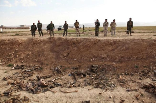 attention-editors-visual-coverage-of-scenes-of-deathkurdish-peshmerga-forces-look-at-bones-in-a-mass-grave-on-the-outskirts-of-the-town-of-sinjar-february-3-2015-police-said-the-mass-grave-contained-remains-from-25-pe